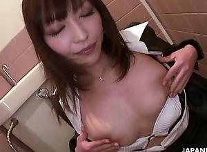 Hot Japanese place slut with big tits masturbates in the bathroom