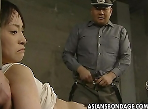 Japanese chick held down and stuffed with respect to fat dicks