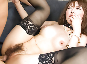 Sayaka Tsuzi moorland thigh highs finds her pussy filled with a lasting dick while she sits in a chair backwards