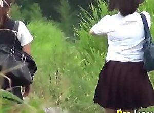 Watched oriental teens in uniform pee