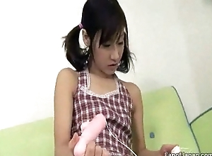 A young Asian girl is playing involving a sex toy, lickin from http://alljapanese.net