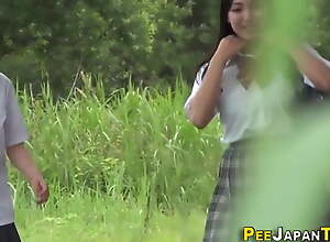 Oriental students peeing outdoors