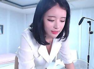 Lovely Korean Teen regarding ripsnorting setting up ribbing
